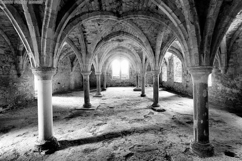 A black and white photo of the inside of Battle Abbey