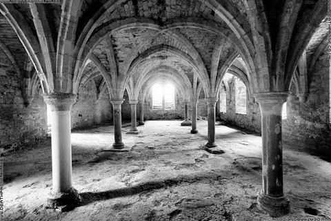 A black and white photo of the inside of Battle Abbey in East Sussex