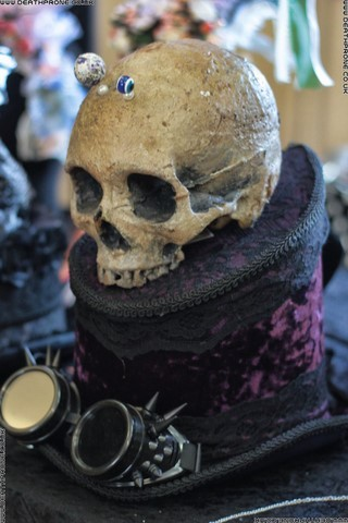 Gothic Steampunk hat with spiky goggles and a skull on top