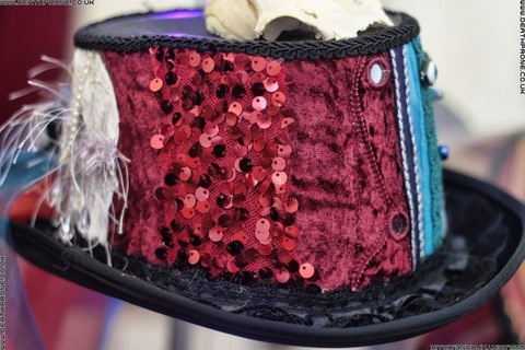 A pretty custom steampunk hat in red, blue, white and black