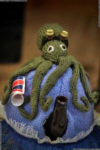 A knitted octopus tea cosy ready for the tea dueling