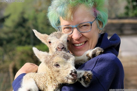 Photo of Helen Tadhunter holding cute lambs